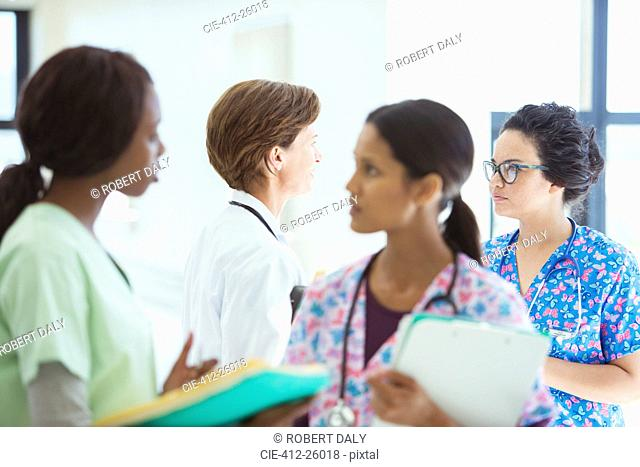 Doctor and nurses talking in hospital