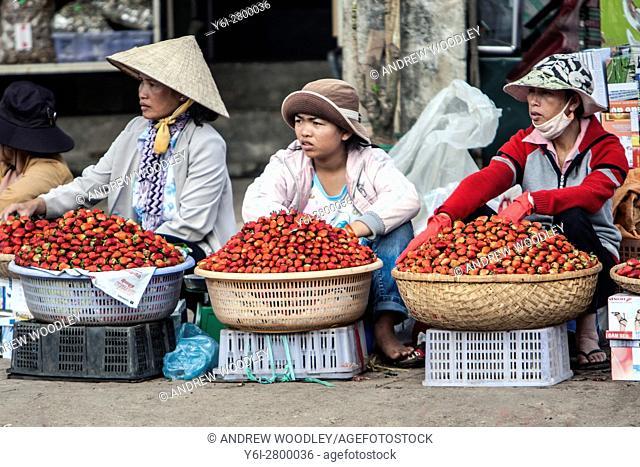 Strawberry vendors Dalat market Vietnam