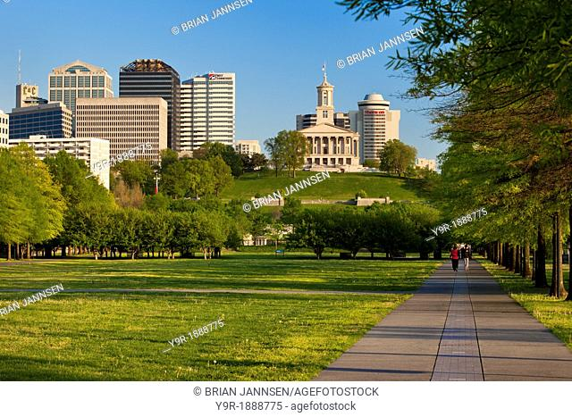 Families enjoying a spring walk through Bicentennial Park below the Capitol Building in Nashville Tennessee USA