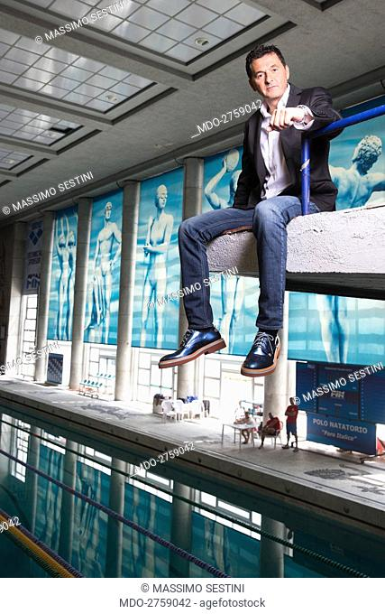 The TV presenter Teo Mammucari on the diving board of the swimming pool at Foro Italico where he records the Tv show Jump! Stasera mi tuffo