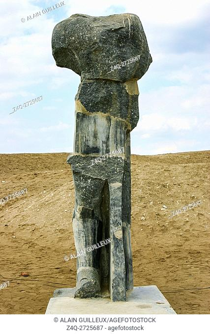 Egypt, Nile Delta, Tanis, relief on the modern processional way to the temple : Damaged statue
