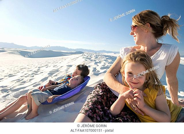 Family relaxing together at White Sands National Monument, New Mexico, USA