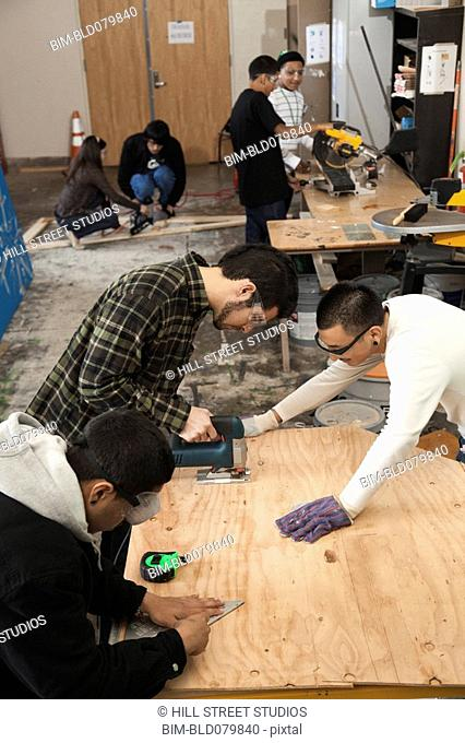 Students working in woodshop class