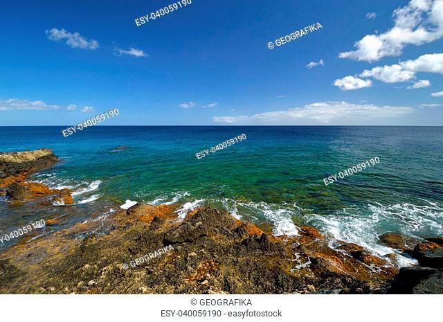 Low tide at the Atlantic Ocean rocky coast. Charco del Palo, Lanzarote, Canary Islands, Spain