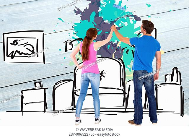 Composite image of couple painting a wall together