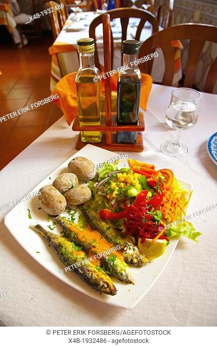 Grilled sardines potatoes and salad in a restaurant San Andres town Tenerife island the Canary Islands Spain Europe