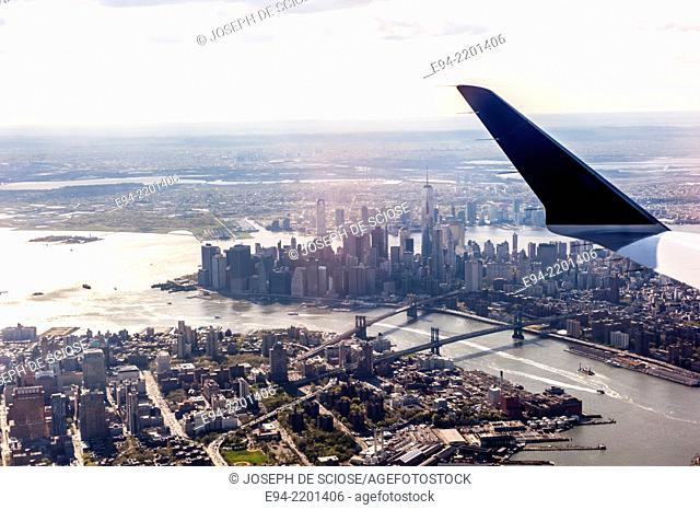 Aerial view of New York City from an airplane showing the East River, Brooklyn, Lower Manhattan, the Brooklyn Bridge and the Manhattan Bridge