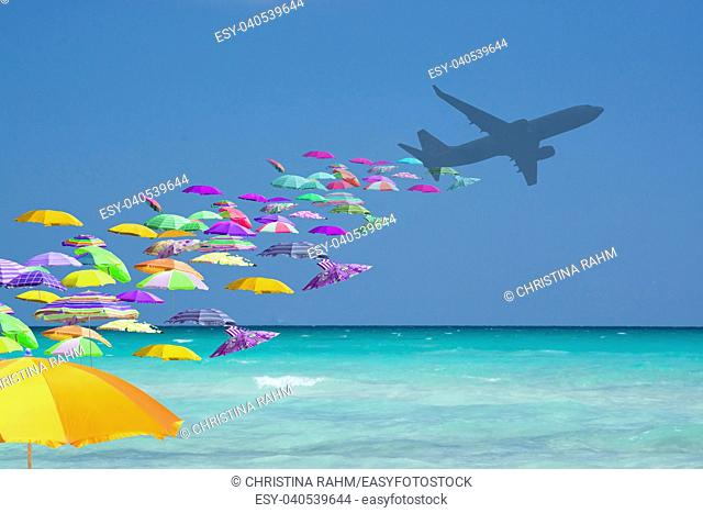 Colorful parasols tourist invasion from airplane turquoise water in tourist paradise travel playful mass tourism concept