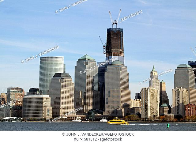 The Freedom Tower under construction and rising from Ground Zero, the scene of the 9/11 terrorist attack  World Financial Center is in the foreground  New York...