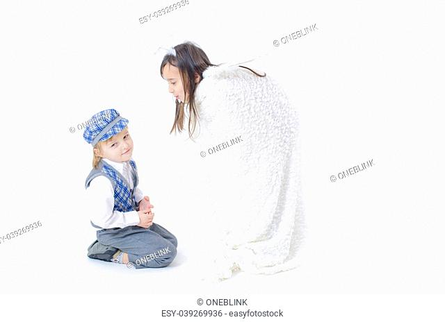 A little boy offering a ring to a girl