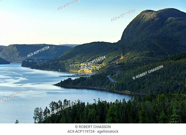 On the south side of Bonne Bay and at the base of Mount Crow is the town of Shoal Brook illuminated by a small point of early morning sunlight