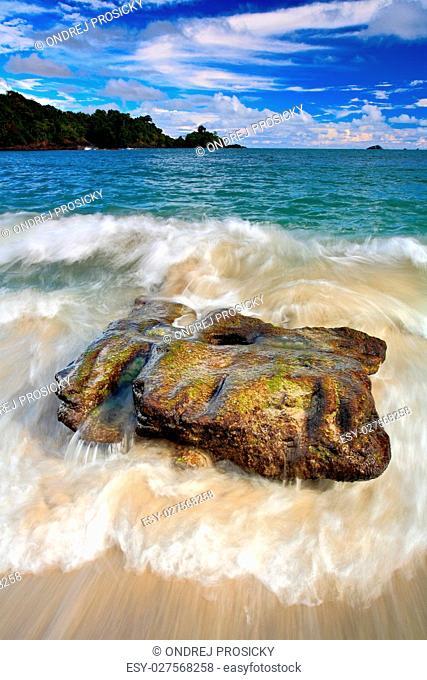 Beautiful sea coast landscape with waves and stone