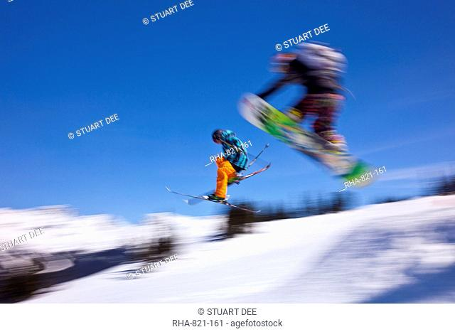 Snowboarder flying off a ramp, Whistler Mountain, Whistler Blackcomb Ski Resort, Whistler, British Columbia, Canada, North America