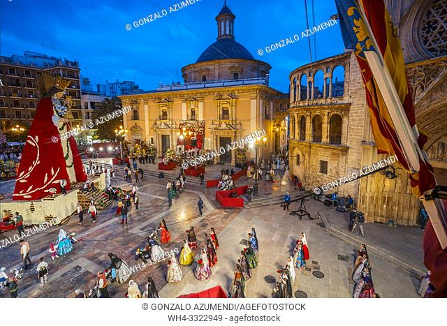 Fallas festival. Falleros and Falleras in traditional dress. Parade to the Plaza de la Virgin in order to make an offering of flowers to Our Lady of the...