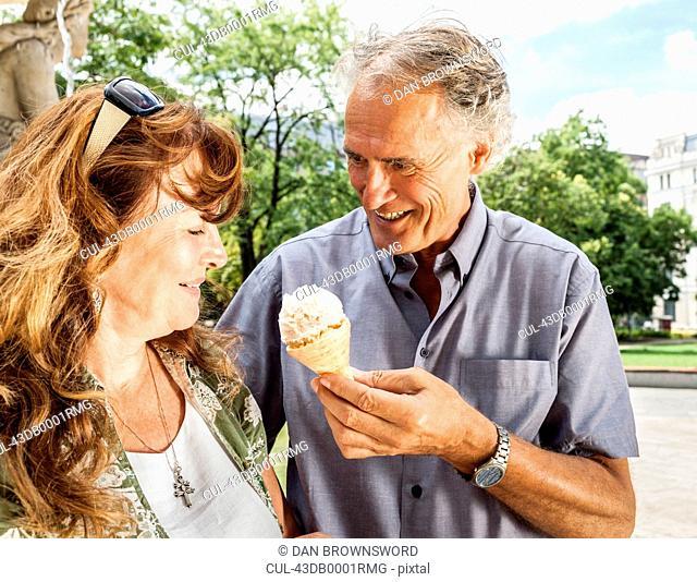 Older man offering wife ice cream