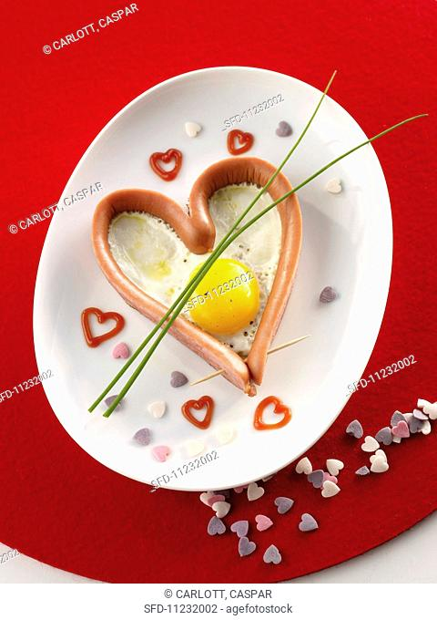 A sausage heart with a fried egg for Valentine's Day