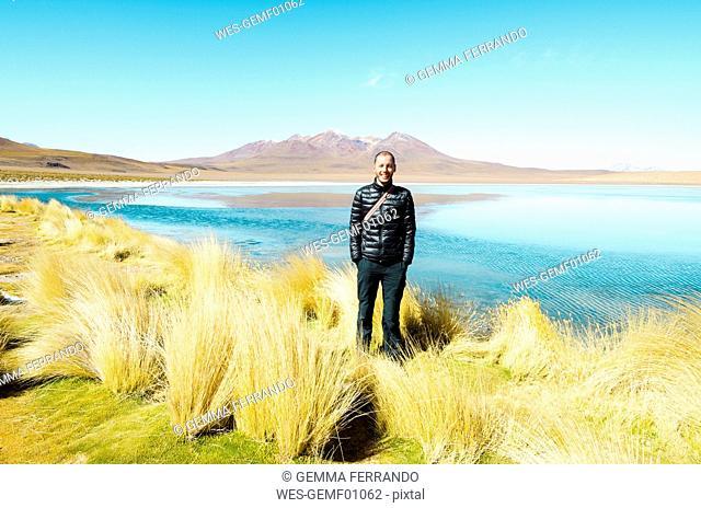 Bolivia, Andes, Altiplano, Man wearing warm clothes at Laguna Honda