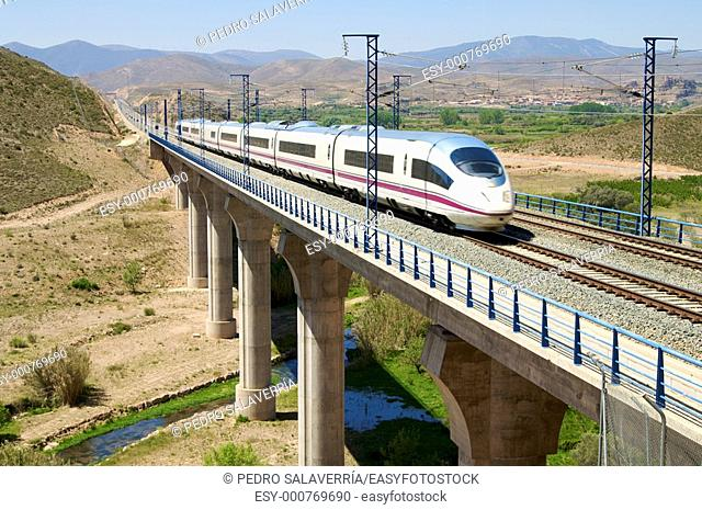 train running on a viaduct in Arandiga, Saragossa, Aragon, Spain