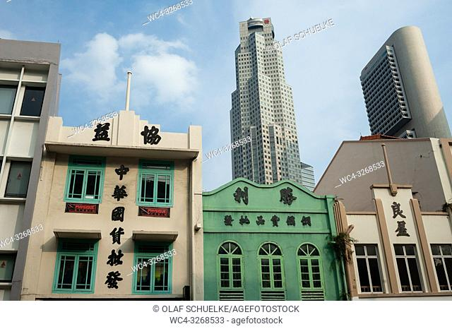 Singapore, Republic of Singapore, Asia - Old buildings along South Bridge Road with modern skyscrapers of the central business district in the backdrop