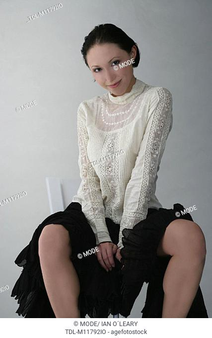 1af9bf434cf Wearing white shirt and black skirt Stock Photos and Images