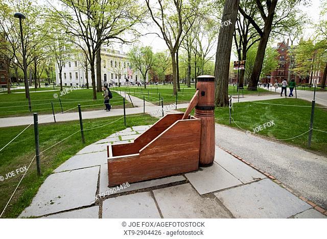 wooden pump sculpture in the old yard harvard university Boston USA