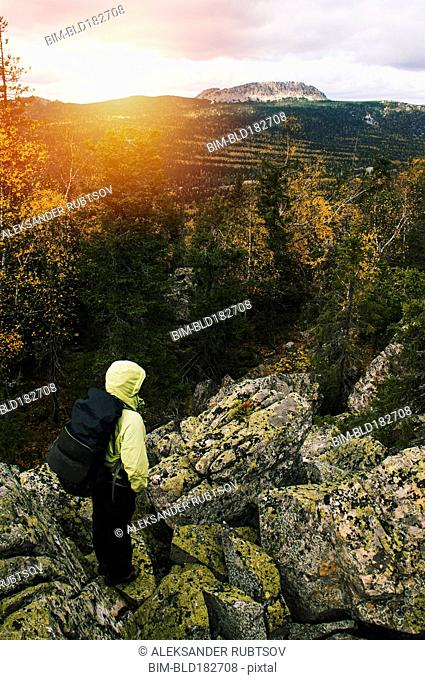 High angle view of hiker on remote mountaintop, Ural, Ural, Russia