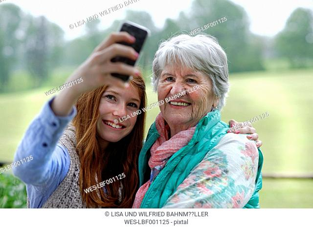 Granddaughter taking selfie of grandmother and herself