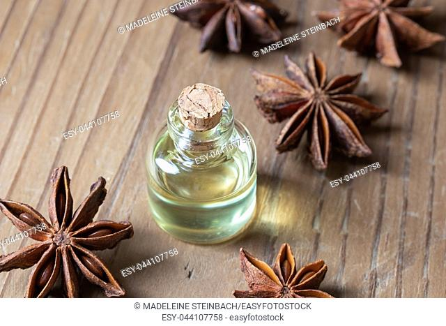 A bottle of essential oil with star anise