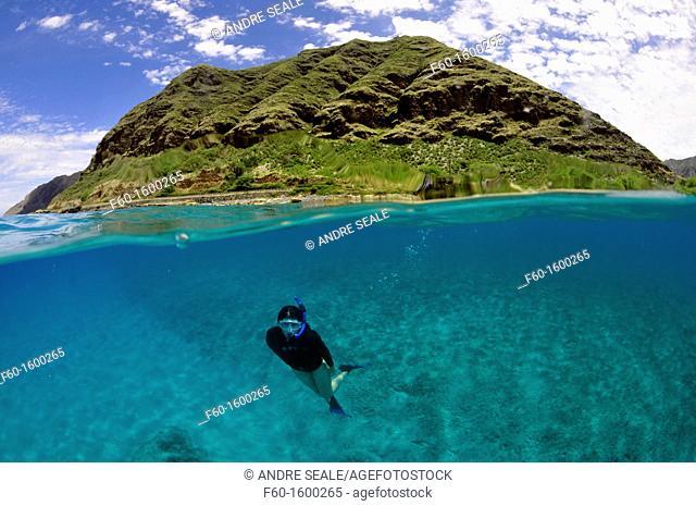 Split image of snorkeler and costal hill, Makua Beach, Oahu, Hawaii, USA