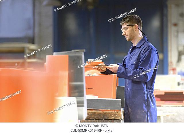 Worker making mould in foundry