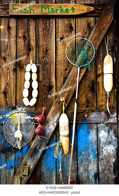 Buoys And Other Gear Hangs On A Wood Barn At A Shellfish Farm On Orcas Island, Washington, Usa