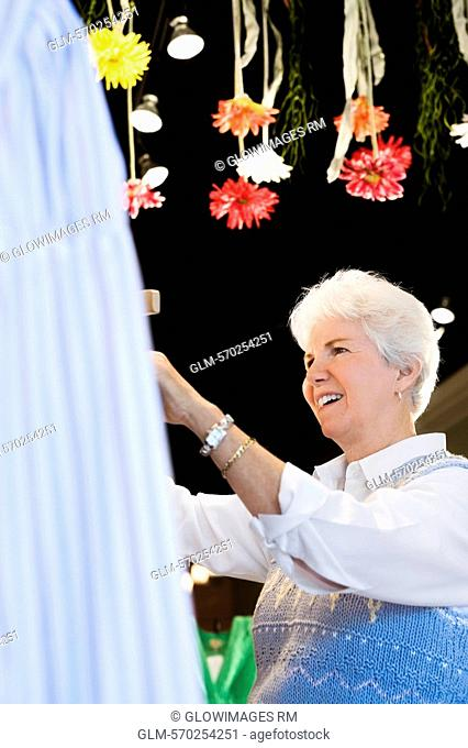 Side profile of a senior woman smiling in a store