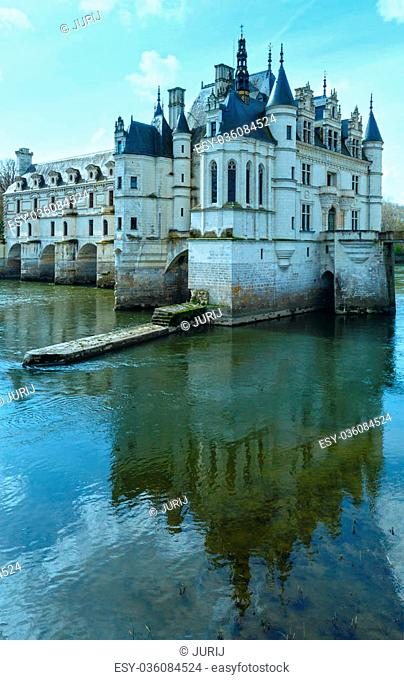 Castle Chenonceau on the River Cher (France). Built in 1514–1522. The bridge over river built in1556-1559 to designs by architect Philibert de Orme and gallery...
