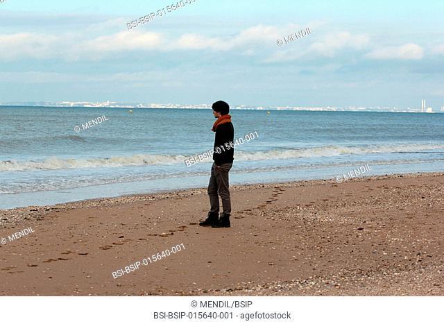 Man strolling on the beach