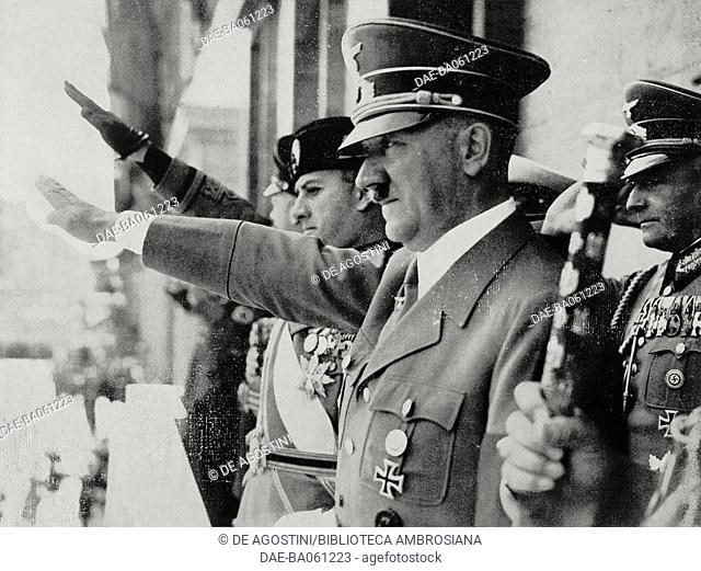 Galeazzo Ciano and Adolf Hitler saluting the crowd from the Palace of the Chancellery in Berlin after signing the Pact of Steel (Stahlpakt) between Germany and...