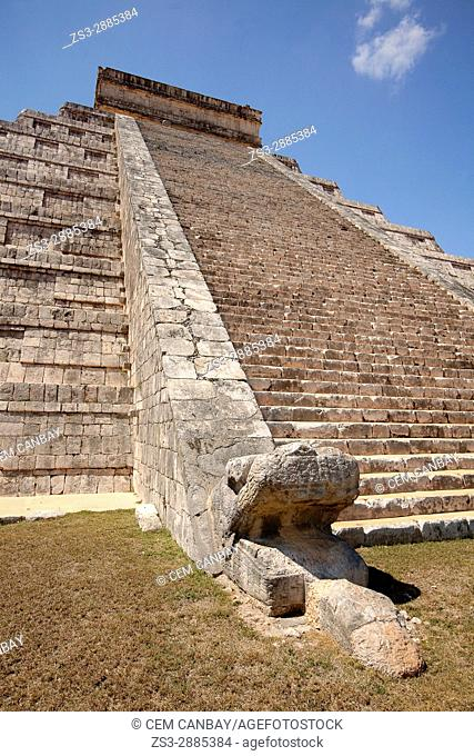 Feathered serpent at the foot of the Pyramid of Kukulcan or El Castillo 'The Castle' at the in Maya Archeological Site Chichen Itza, Yucatan Province, Mexico
