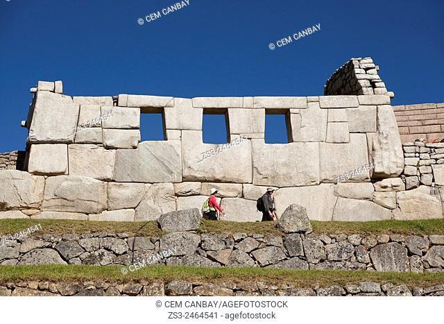 Tourists in front of the Three Windows at Machu Picchu, Unesco World Heritage Site near Cuzco, Urubamba Valley, Peru, South America