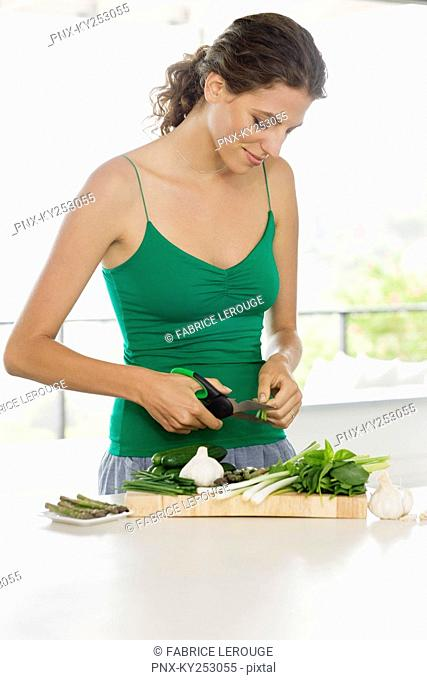 Woman chopping vegetables in the kitchen