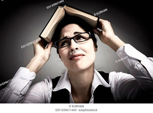 Tired student woman with books. Conceptual background
