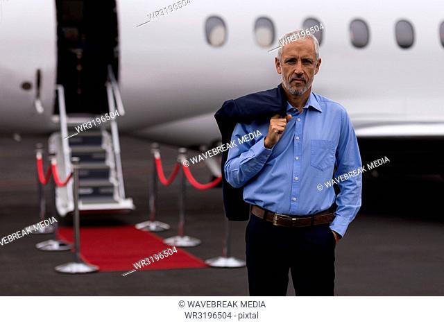Businessman standing on a runway