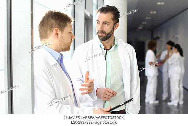 Doctors and nurses talking in corridor, Hospital, Spain