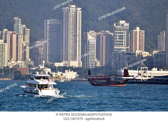 Hong Kong: boats and flat apartments in Victoria Harbour