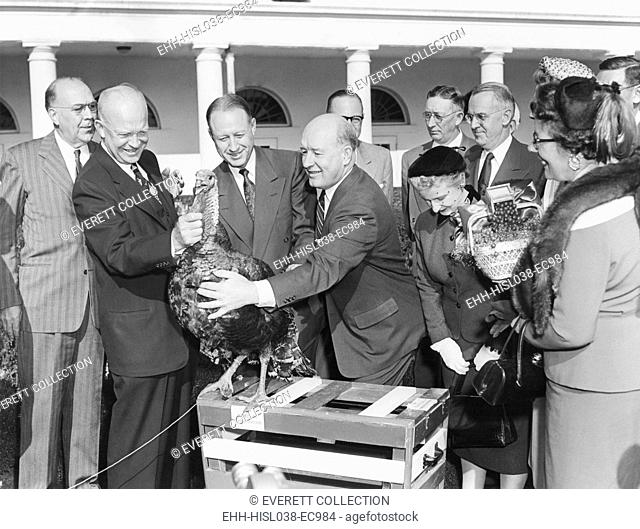 President Dwight Eisenhower receives a turkey from members of the National Turkey Federation at the White House. Nov. 16, 1953. - (BSLOC-2014-16-172)