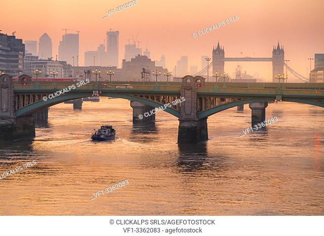 Romantic sunrise over Southwark Bridge and London Bridge along River Thames, London, United Kingdom