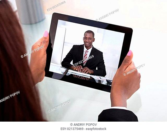 Businesswoman Attending Video Conference With Colleague On Digital Tablet