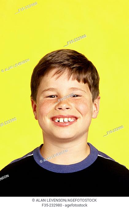 Head shot of young boy with big smile