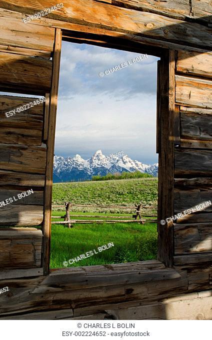 View of the Teton Mountain Range from an old miner's cabin, Grand Teton National Park, Teton County, Wyoming, USA