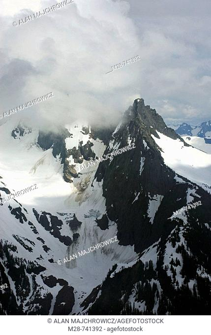 Clouds swirling around the summit of Mount Sefrit 7151 feet, 2180 meters, North Cascades National Park, Washington, USA