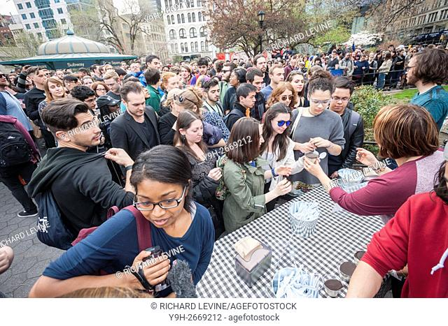 Volunteers scoop ''Bernie's Yearning'' ice cream to Bernie Sanders supporters lined up in Union Square Park in New York