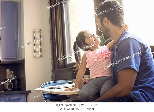 Father and daughter in kitchen